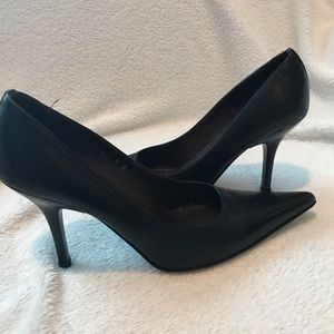 Black pointed stiletto heels by Donald Pliner